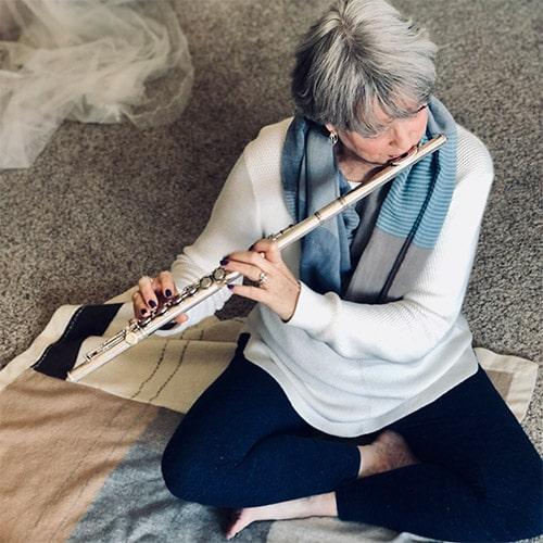 Heidi Playing Flute on Rug